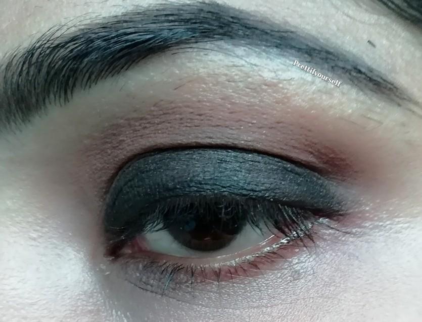 again apply brown eye shadow on crease line