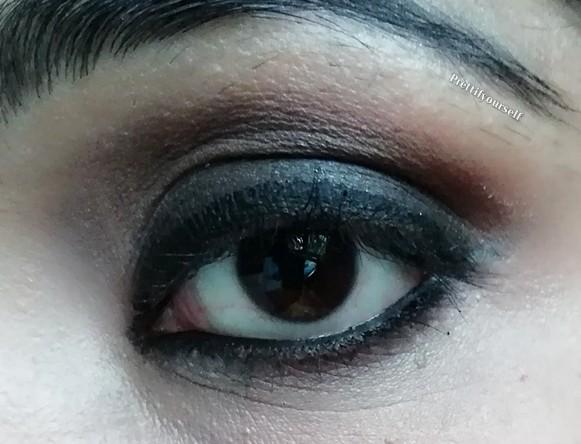 aply black eyeliner and kajal