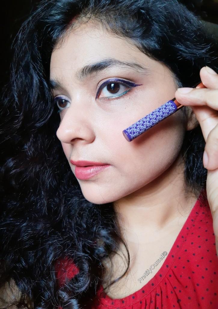 application of violet eyelinerof kay beauty